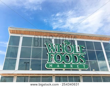 Close-up Logo Of Whole Foods Market At Store Entrance Facade