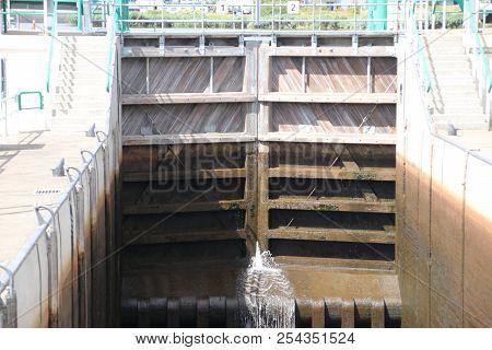 Sluice In The Lemstervaart Canal To Inner Lake Ijsselmeer In Lemmer. Difference Between Waterheights