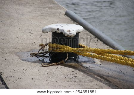 Rope Around A Bollard To Secure A Ship In The Port Of Rotterdam In The Netherlands