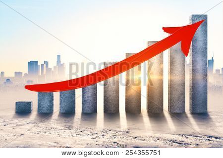 Concrete Chart Bars With Upward Red Arrow On City Background With Sunlight. Financial Growth And Suc