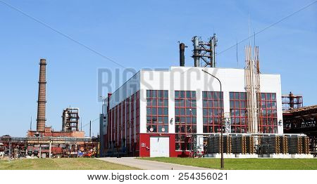 A Large Concrete Technological Industrial Installation At A Chemical Petrochemical Refinery With Cap