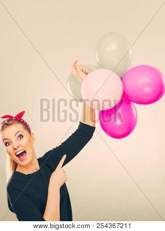 Craziness And Lots Of Fun. Cute Crazy Joyful Girl Playing With Colored Balloons. Blonde Playful Retr