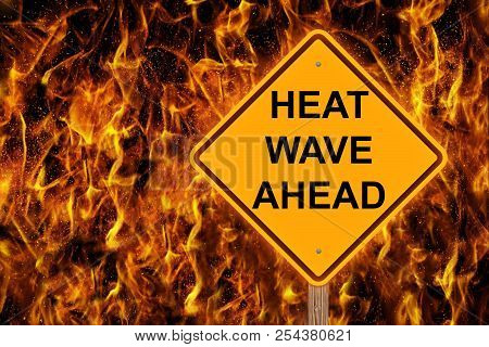 Heat Wave Ahead Caution Sign With Flaming Background