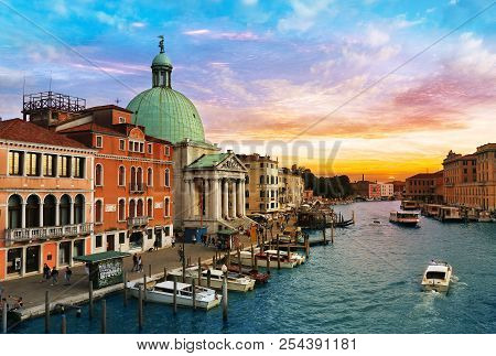 Venice, Italy, Jun 8, 2018: View Of Church Of San Simeon Piccolo With Vaporetto And Boats On Grand C