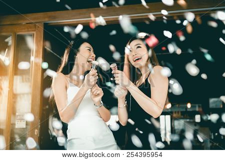 Asian Young Women Having A Celebrate Together.