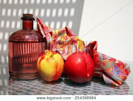Still Life With Fresh Lemonade In Vintage Glass Botlle, Two Ripe Nectarines And Beautiful Napkin Aga