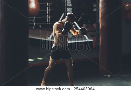 Kickboxer Is Exercising With Outfit In Gym