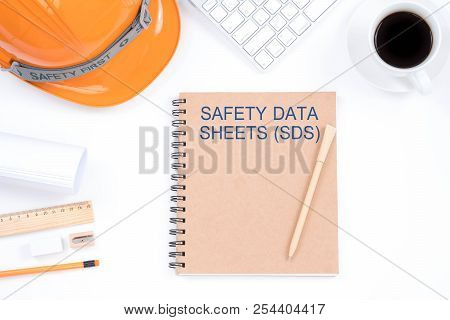 Concept Safety Data Sheets (sds). Top Viwe Of Modern Workplace With Safety Helmet, Office Supplies,