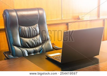 Chair Empty And Computer Notebook Workplace In Office, Office For Boss With Sun Illumination,select