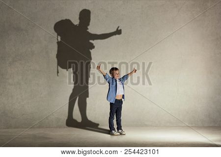 The Little Boy Dreaming About Tourism And Adventure. Childhood And Dream Concept. Conceptual Image W