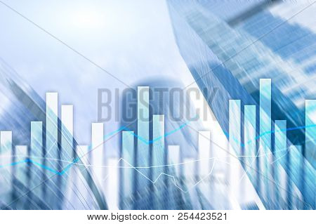 Financial Graphs And Charts On Blurred Business Center Background. Invesment And Trading Concept.