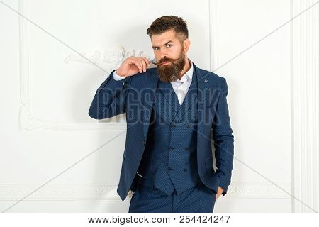 Brutal Bearded Male Touches His Moustache. Solid Man With Beard And Mustache. Athletic Bearded Man.