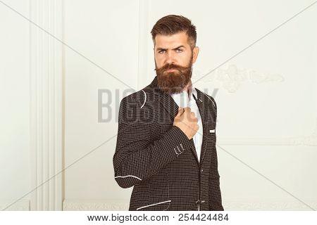 Handsome Bearded Businessman In Classic Suit Is Adjusting His Jacket. Portrait Of Elegant Rich Confi
