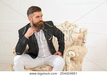 Imposing Well Dressed Man Sitting On Couch. Men's Beauty, Fashion. Cool Man In Formal Wear, Tux Pock