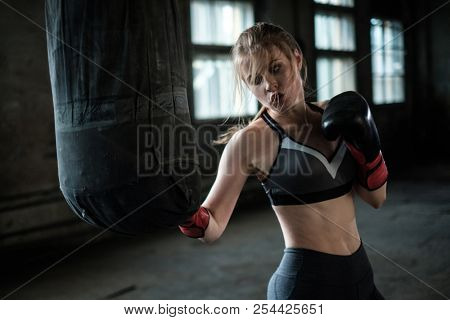 Female Boxer preparing for training in Boxing Club
