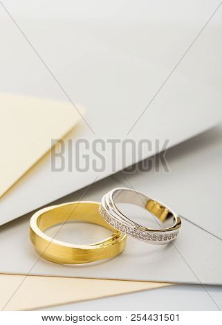 Gold And Silver Wedding Rings On Envelope Background. Wedding Invitation Concept. Copy Space