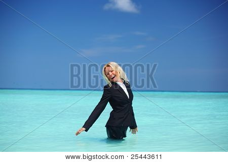 business woman stay in ocean waves