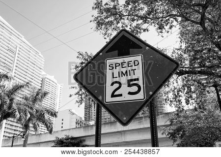 Speed Limit Warning In Miami, Usa. Traffic Sign On City Road. Caution And Warn Concept. Transportati