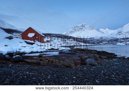 Landscape Of Norway In Winter During Blue Hour. Norwegian Coastline In Winter. Mountain Covered With