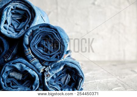 Roll Blue Denim Jeans On Gray Background A