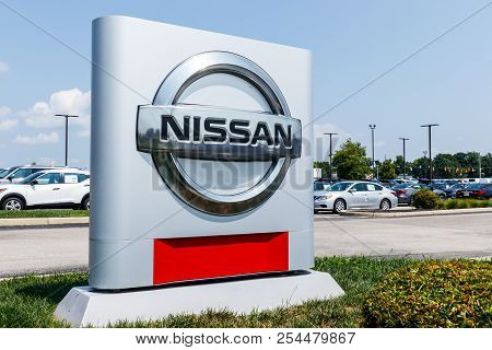 Fishers - Circa August 2018: Logo And Signage Of A Nissan Car And Suv Dealership. Nissan Is Part Of