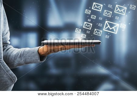 Side View Of Hand Holding Touchpad With Drawn Email Icons On White Background. E-mail Marketing Conc