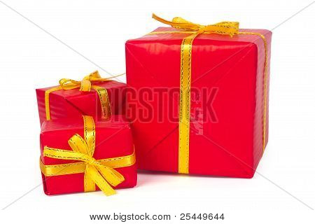 Three Red Gift Boxes With Yellow Bows And Ribbons