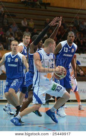 KAPOSVAR, HUNGARY - OCTOBER 15: Nik Raivio (white 33) in action at a Hugarian National Championship basketball game Kaposvar (white) vs. Jaszbereny (blue) on October 15, 2011 in Kaposvar, Hungary..