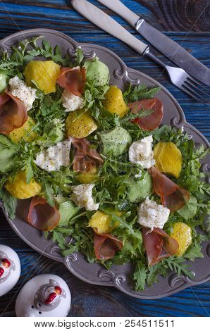 Salad With Mango Avocado Mozzarella And Arugula