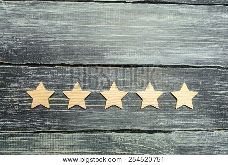 Five Stars On A Dark Background. The Concept Of Rating And Evaluation. The Rating Of The Hotel, Rest