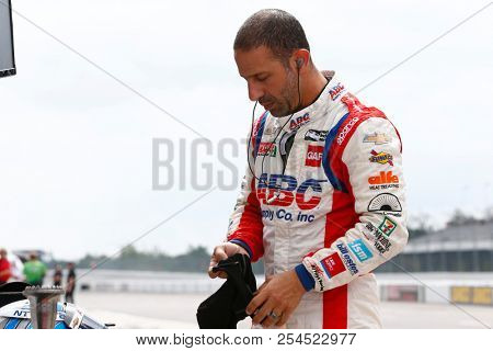 August 18, 2018 - Long Pond, Pennsylvania, USA: TONY KANAAN (14) of Brazil hangs out on pit road prior to practice for the ABC Supply 500 at Pocono Raceway in Long Pond, Pennsylvania.