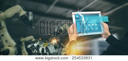 Iot Industry 4.0 Concept,industrial Engineer Using Software (augmented, Virtual Reality) In Tablet T