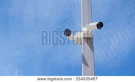 Cctv Surveillance Security Camera Video And Blue Sky Concept - Cctv Surveillance Security Camera Vid