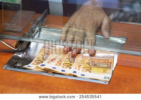Cash Money Euro, At Bank Office Or Currency Exchanger. Male Hand With Euro Money In Cash Department