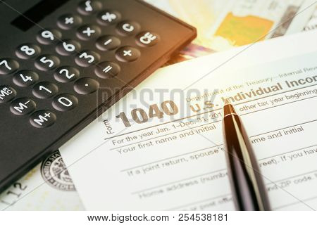Tax Submission Or Revenue Calculation Concept, Pen On 1040 Us Individual Income Tax Filling Form Wit