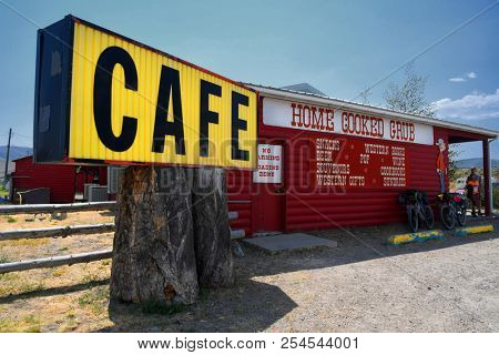 LIMA, MONTANA, USA - August 11, 2018: Exterior of a log cabin cafe featuring home cooked grub