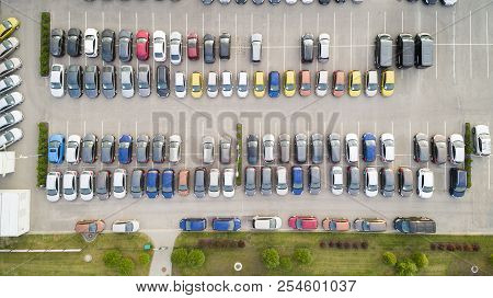 Parking Lots, Top View. Aerial View Of A Colorful Cars Parked In A Parking.