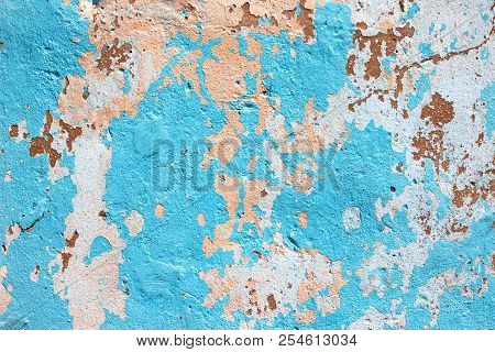 Shabby Concrete Wall Texture With Peeling Paint Blue And Orange Colors. Grungy Background