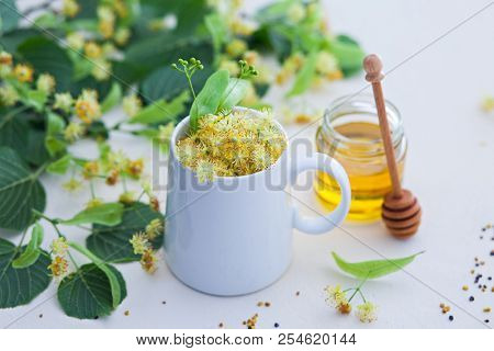 cup of linden tea and linden honey - healthy lifestyle