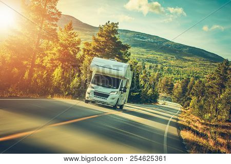 Camper Van Summer Trip. Scenic Norway Landscape And The Recreational Vehicle.