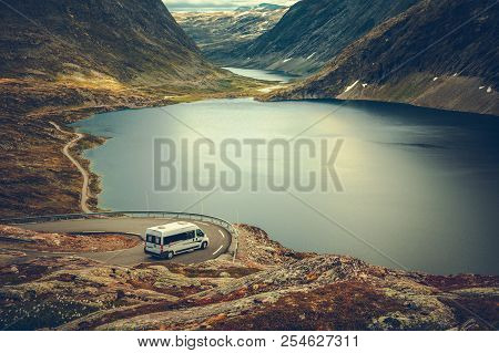 Rv Camper Scenic Road Trip. Raw Norwegian Landscape And The Camper Van Recreational Vehicle On The W