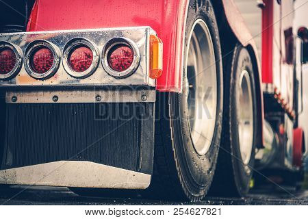Semi Truck Rear Lights Closeup. American Long Haul Trucking Theme.