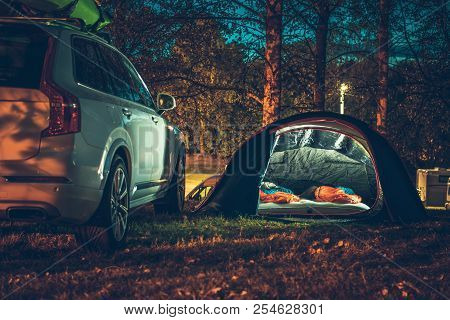 Tent Camping In The Forest. Traveling By Car And Camping With A Tent. Summer Travel Theme.