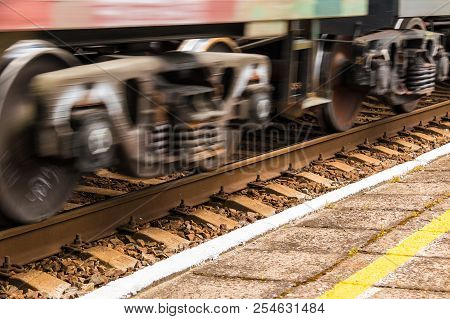 Motion Blurred Wheels Of A Moving Train Carriage Closeup