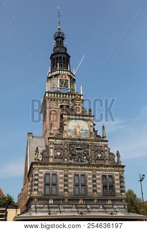 Alkmaar, Netherlands - July 20, 2018: Facade with the tower of the historical Waag building, weighing-house, a historical national monument