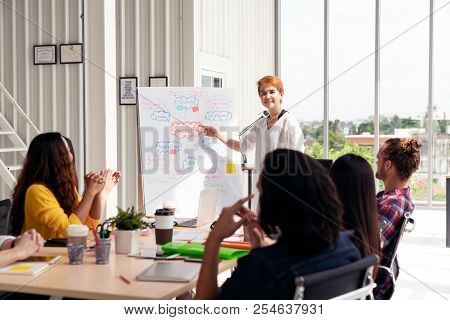 Senior Asian Creative Businesswoman Standing And Making Presentation At Modern Office Happy Talking