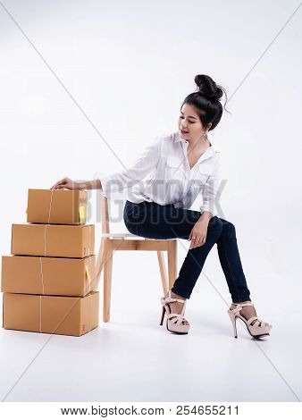 The Lady In White Shirt,blue Jeans And Pink Pastel High Heel Shoes,posing By Put Right Hand On Top O