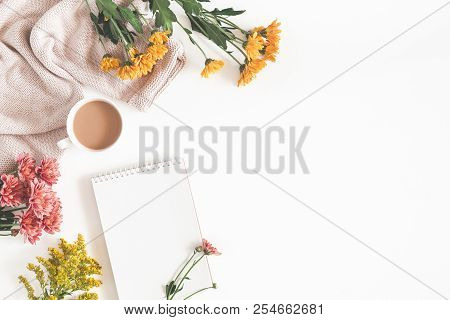 Autumn Composition. Cup Of Coffee, Notepad, Fresh Flowers On White Background. Autumn, Fall Concept.