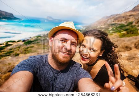Young Happy Couple Taking Selfie Photo With Island And Turquoise Water. Self Portrait Of Couples In