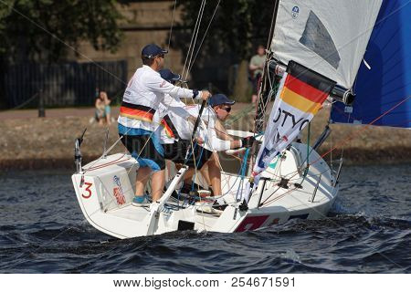 ST. PETERSBURG, RUSSIA - AUGUST 3, 2018: Team Deutscher Touring Yacht-Club from Germany compete in Semifinal 2 of Sailing Champions League. 25 sailing teams participate in the competitions